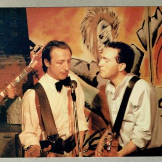 1986: as host of Joey Valentino's Cabaret Club. Cracking jokes, also singing and playing in the house band (here with Ken Steedman).
