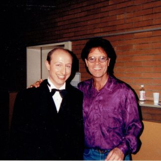 With Cliff Richard, backstage in Bochum, Germany. My bare bottom made its debut television appearance.