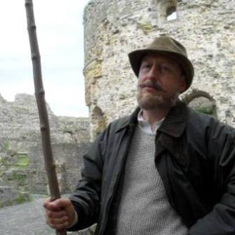 The character, Harold Addington, disguised as the Angry Shepherd. Location, Camber Castle.