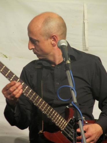 Performing on bass and lead vocal with Dr. Joe Joe at Woodfest, Hertfordshire